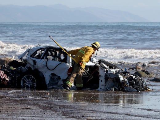 California mudslide: At least 18 dead as teams