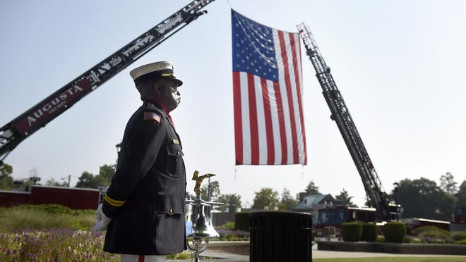 Augusta (Ga.) Fire Department Capt. Harmon Brown waits to ring the bell marking the moment one the World Trade Center towers was struck by an aircraft 18 years ago in NYC.  Photograhed during the September 11th Rememrance Ceremony Wednesday morning in Augusta, Ga., September 11, 2019.