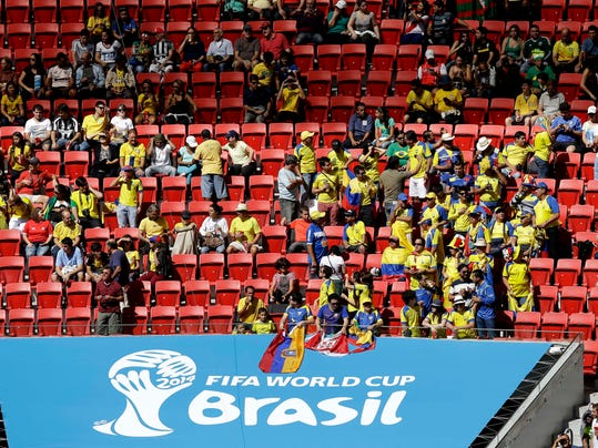 Ecuador fans sit between unoccupied seats during the group E World Cup soccer match between Switzerland and Ecuador at the Estadio Nacional in Brasilia, Brazil, Sunday, June 15, 2014.  (AP Photo/Themba Hadebe)