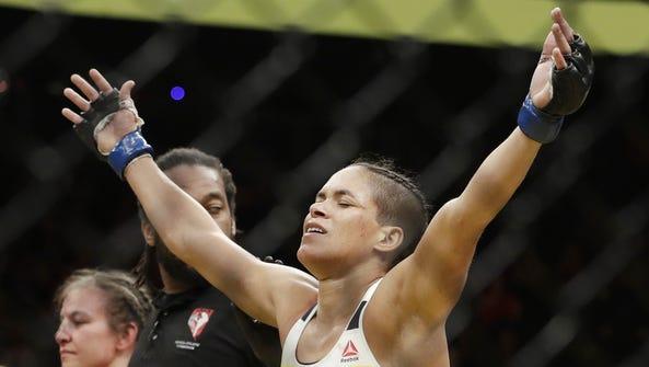 Amanda Nunes celebrates after defeating Miesha Tate