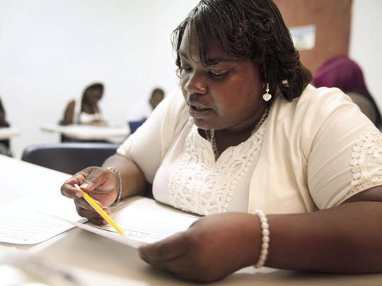 Jowanna Leggette works on a science problem in the GED program that helps young men and women over the age of 22 to get high school diplomas, then to find jobs.