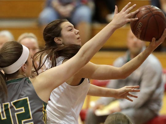 Seymour's Hailey Oskey puts up shot against Beaver Dam's Aly Van Loo during their WIAA Division 2 sectional final girls' basketball game Saturday in Neenah.