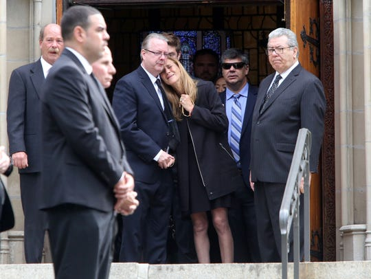 Robby Schartner's casket is removed form the church