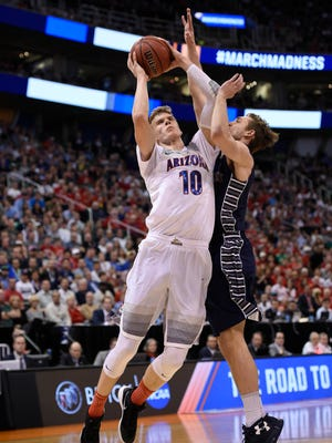 Arizona Wildcats forward Lauri Markkanen (10) moves to the basket against  the Saint Mary's Gaels during the first half in the second round of the 2017 NCAA tournament at Vivint Smart Home Arena.