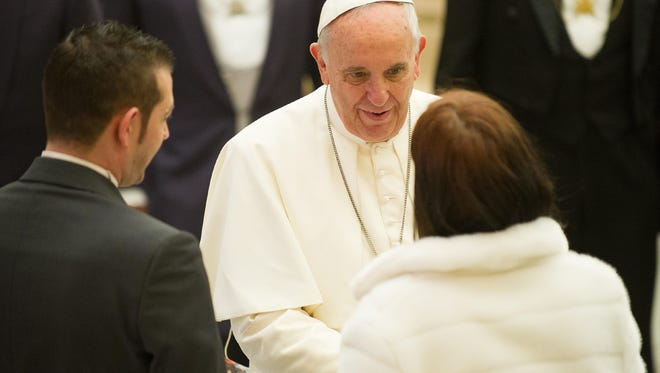 Pope Francis greets Catholics at the Vatican on Wednesday.