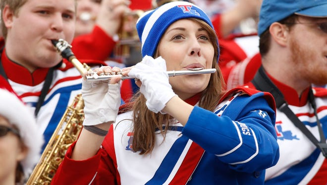 In this 2014 file photo, Louisiana Techmarching band member plays during the game against the Illinois Fighting Illini  in the Heart of Dallas Bowl at Cotton Bowl Stadium.