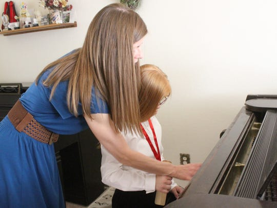 For the last five years, 14-year-old Christina Clapp has been home schooled and taking piano lessons from her mother, Daniela Clapp,  as a form of music therapy.
