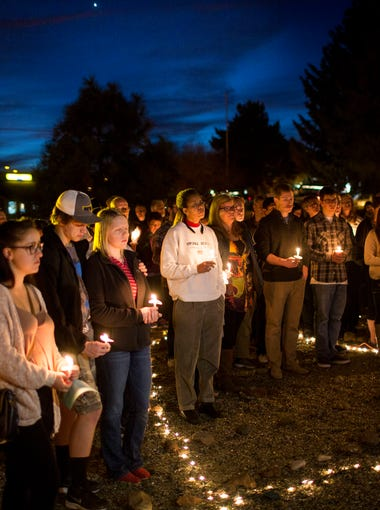 Members of the community gather at a candlelight vigil for Kayla Mueller at the NAU Lutheran Campus Ministry  February 14, 205 in Flagstaff, Arizona. Mueller died whilst being held prisoner by ISIS in the middle east.