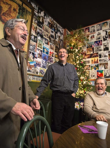 Gov. Terry Branstad, left, shares a laugh with Brad Grotewold (center) and Don Grotewold at the Grand Cafe before lunch Tuesday, Nov. 24, 2015, in Lake Mills.