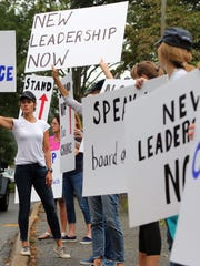 Parents protest outside Chappaqua school district headquarters in September asking for new leadership in the wake of the Christopher Schraufnagel scandal.