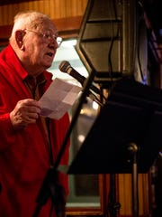 Bob Swain, of St. Clair, reads a poem titled 'Protest', written by himself and Lora Lerash during the Bootlegger Balladeer Wednesday, Jan. 25, 2017 at LaCroix's Riverside Pub in St. Clair.
