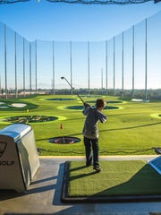 Children can take advantage of the driving range at Topgolf