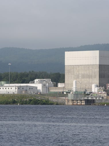 The Vermont Yankee Nuclear Power Plant in Vernon, Vermont, as seen from across the Connecticut River from New Hampshire, June 19, 2017. The large cube is the reactor building.