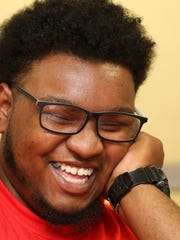 """Javoughn """"Juju"""" Brown, 20, laughs while playing chess as he supervises the game room at the Cabbage Patch Settlement House.  Brown attended programs at the facility as a youth and is a recipient of a scholarship as Cabbage Patch College Scholar.  He attends the University of Kentucky.Aug. 4, 2017"""