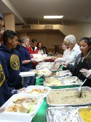 The Haverstraw Neighborhood Organization's holds its 23rd annual free Thanksgiving meal at the Quisqueya Sports Club in Haverstraw on Nov. 24, 2016.
