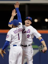 New York Mets left fielder Brandon Nimmo (9) and shortstop