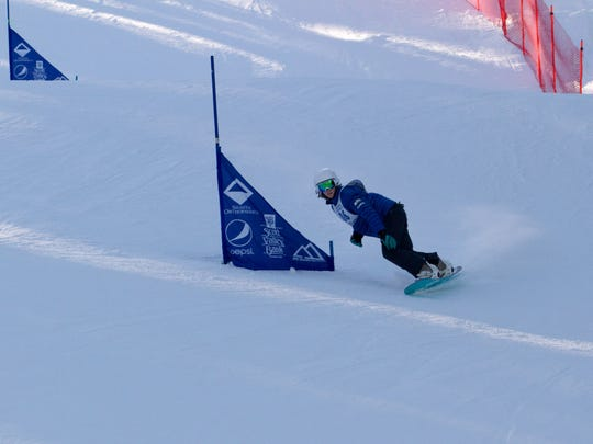 Tate Harkness of Mount Shasta High School competes Monday at Mt. Shasta Ski Park. She was the winner in the girls snowboarding competition.