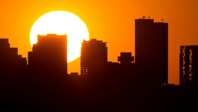 Sunset on June 25, 2013, in downtown Phoenix.