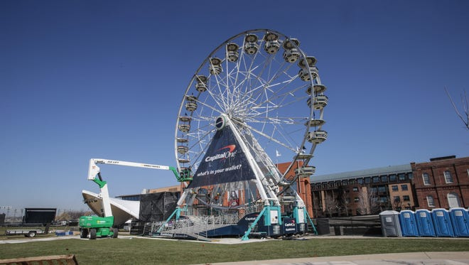 A work crew puts final touches on a large ferris wheel  at the White River State Park for the March Madness Music Festival, Wednesday April 1st, 2015.