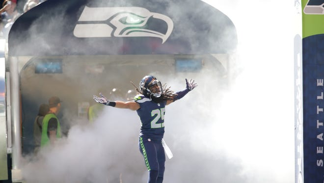 Seattle Seahawks cornerback Richard Sherman (25) runs out of the tunnel for an NFL football game against the Chicago Bears, Sunday, Sept. 27, 2015, in Seattle.
