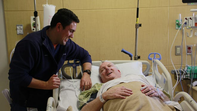 Nick Santoiemma, a registered nurse in the Cardiac Critical Care Unit at the Norman and Denise Guilloud Cardiovascular Center at Hunterdon Medical Center, cares for James Mooney, the first patient admitted to the unit.