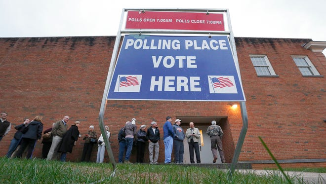 Voters wait in line for a polling place to open on Saturday, Feb. 20, 2016 in Greenville, S.C.