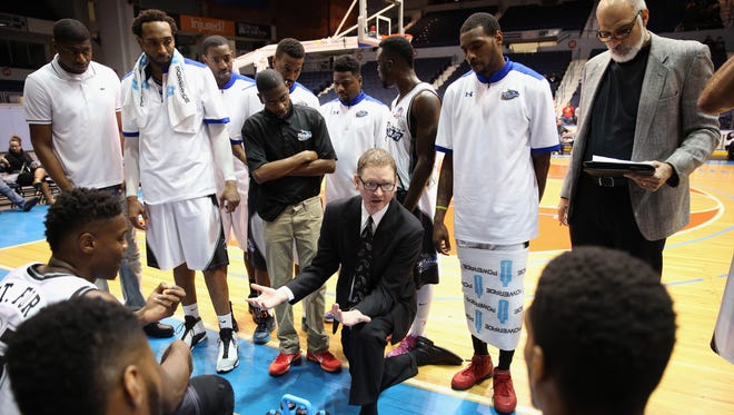 Razorsharks head coach Chris Iversen with his team during a timeout.