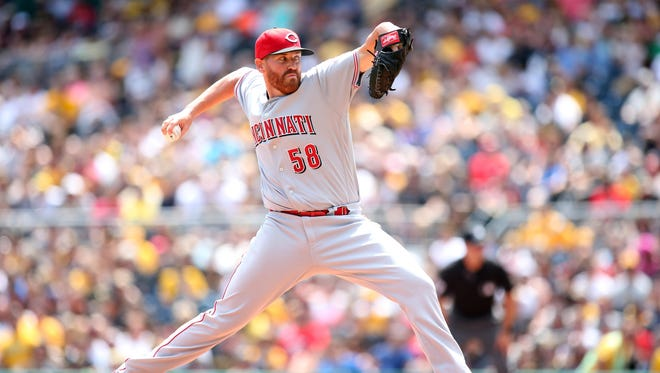 Cincinnati Reds starting pitcher Dan Straily (58) delivers a pitch against the Pittsburgh Pirates during the second inning at PNC Park.