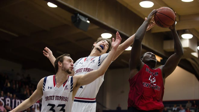 Dec 14, 2016; Moraga, CA, USA; St. Mary's Gaels forward Kyle Clark (33) and center Jordan Hunter (1) extend for the ball as the rebound is controled by Western Kentucky Hilltoppers forward Anton Waters (42) during the second half at McKeon Pavilion. St. Mary's defeated Western Kentucky 73-51. Mandatory Credit: Kelley L Cox-USA TODAY Sports