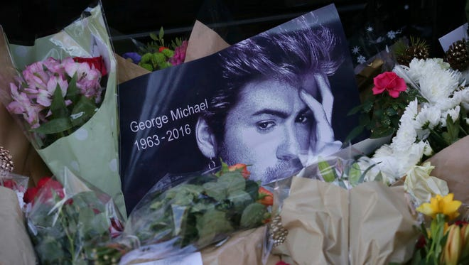 Tributes have been left outside the home of British musician George Michael in London.