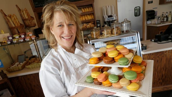Toren Engseth (a.k.a. Madame Macaron), pastry chef at North Shore Boulangerie in Shorewood, shows off an assortment of her macarons.