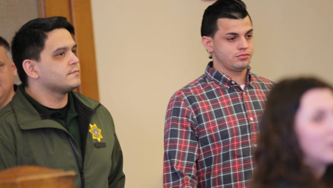 Carlos Hernandez-Ventura, who faces three counts of first-degree murder, stands inside the Dallas County Courthouse for his trial on Tuesday.