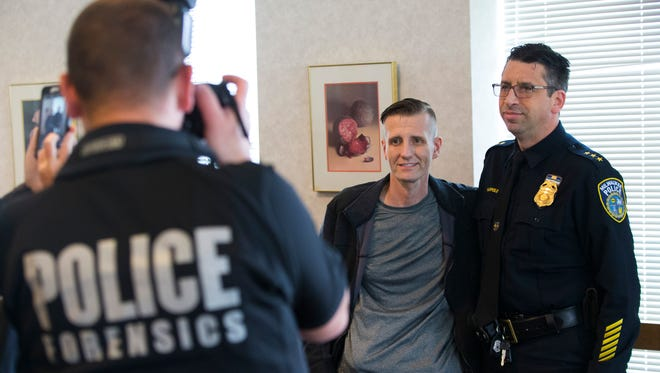 Sebastian Raclaw (left) poses for a photo with Milwaukee Police Department Assistant Chief James Harpole during Raclaw's retirement party Friday. A Milwaukee police lieutenant, Raclaw is battling a rare form of abdominal cancer.