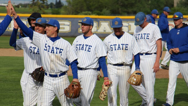 SDSU baseball players celebrate Thursday's 5-3 Summit League win over Omaha.