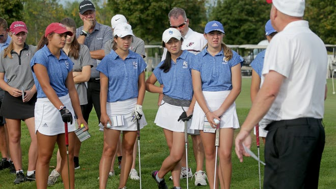 Brookfield Central High School golfers (from left) Lexi Romero, Emily Balding, Sophia Sun, and Emma Whitfield listen to Randy Howard, Sussex Hamilton coach before the start of the Greater Metro Conference tournament at Morningstar Golf Club in Waukesha