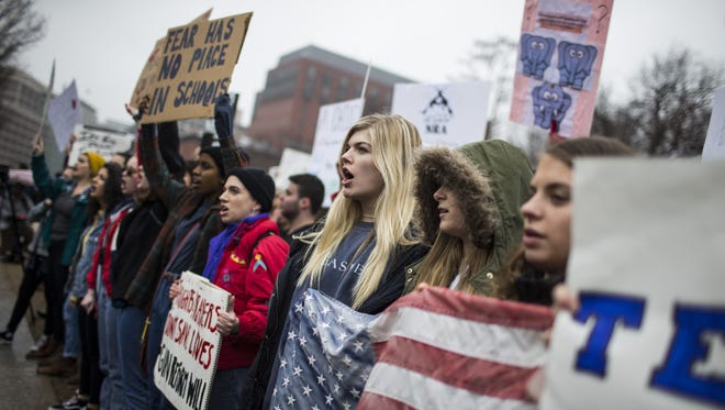 """Demonstrators chant during a """"lie-in"""" demonstration supporting gun control reform near the White House on Feb. 19, 2018 in Washington, D.C."""