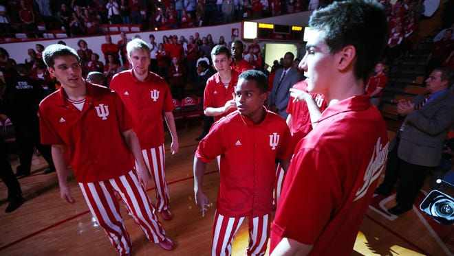 Indiana Hoosiers guard Yogi Ferrell, center, and teammates come out of the spotlight at introductions to face the Greyhounds. Indiana hosted the University of Indianapolis in a preseason game at Assembly Hall on Monday, November 10, 2014.