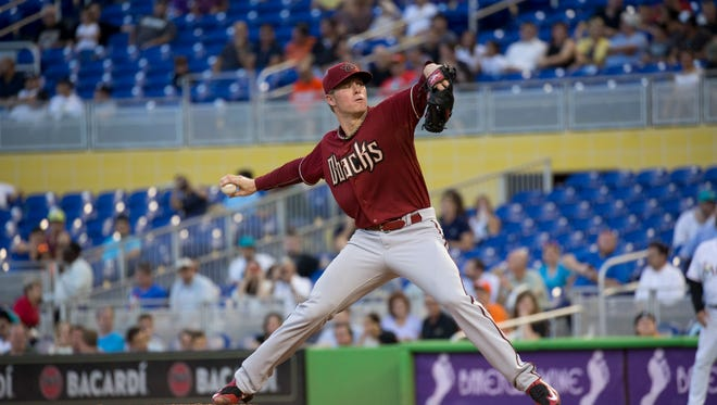 Arizona Diamondbacks starting pitcher Chase Anderson (57) throws to the Miami Marlins during the first inning of a baseball game in Miami, Wednesday, May 20, 2015.