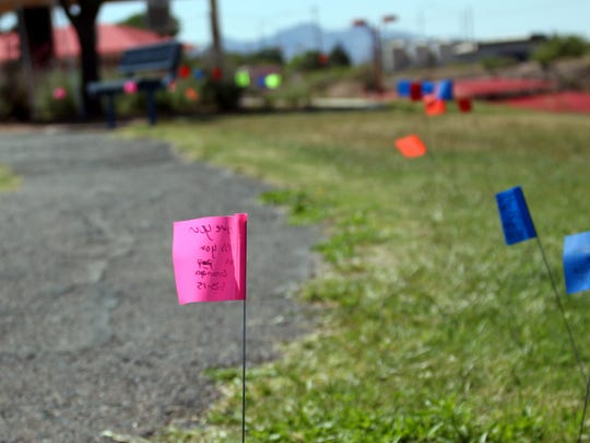 Planted flags dotted the waling path of Voiers' Park on Saturday carrying the names of loved ones who fought cancer and continue to carry the fight against cancer.
