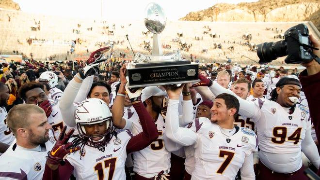 Arizona State celebrates its Sun Bowl victory over Duke.