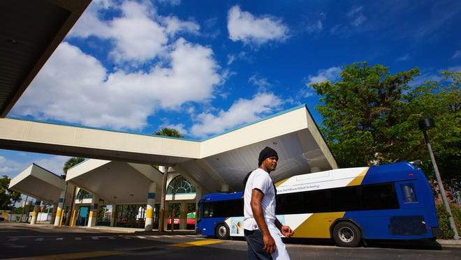 "Noah Roberts gets off a Lee Tran bus Sunday at the Rosa Parks Transportation Center in downtown Fort Myers. ""The buses are nice inside but they just don't come often enough,"" says Roberts who relies on the bus to get to work."