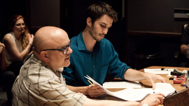 Tyler Durham (right) oversees the recording of one of his pieces.