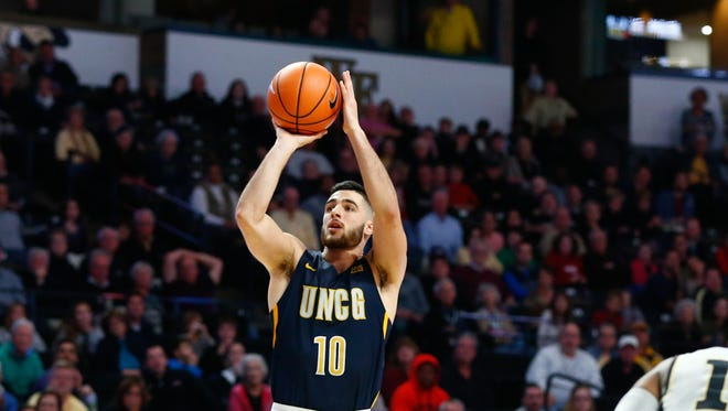 Francis Alonso scored 17 points to help UNC Greensboro to an upset victory over N.C. State on Saturday.