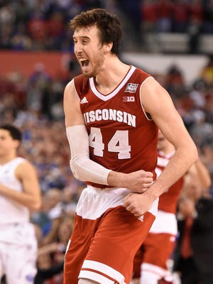 Wisconsin Badgers forward Frank Kaminsky (44) celebrates defeating the Kentucky Wildcats 71-64 in the 2015 NCAA Men's Division I Championship semifinal game at Lucas Oil Stadium.