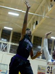 Haywood County's Lakendrick Calloway goes up for a shot during Tuesday night's game against North Side High School.
