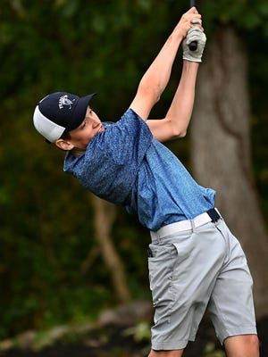 Franklin's Jack Paterson tees off during a match last fall against Medway at Franklin Country Club.