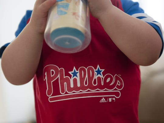 Derek Timm Jr. shows off his Phillies gear at his Gloucester City home.