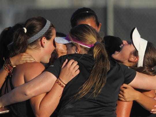 Chiles' Gracie Wilson screams while celebrating with her teammates after beating Niceville to advance to the state tournament. The Timberwolves won two matches at state, then lost in the finals 4-3 to claim state runner-up.