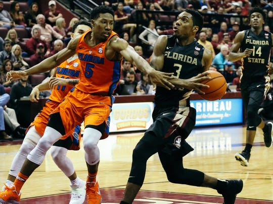 Trent Forrest (3) drives to the basket during the second half against the Florida Gators on Sunday, December 11, 2016. The Seminoles defeated the Gators 83-78.