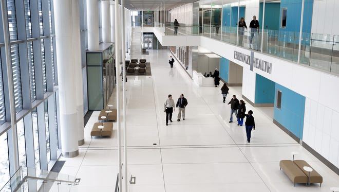People walk through the new Eskenazi Hospital. The hospital is planning to open a new brain care center next year.
